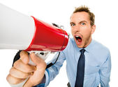 Aggressive businessman shouting with megaphone — Stock Photo