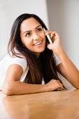 Closeup portrait of attractive young teenage girl talking mobile — Stock Photo