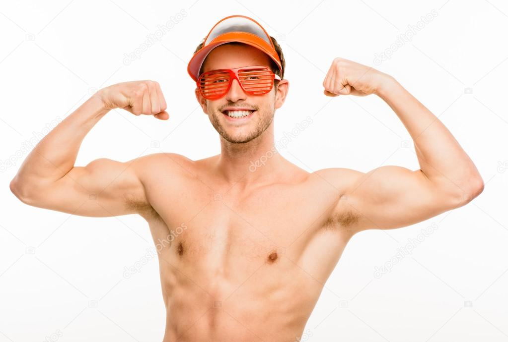 Closeup of attractive young man flexing bicep muscles on white background — Stock Photo #14814683