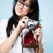 Cute young girl photographer holding retro camera is a hipster - Stock Photo