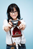 Cute young girl photographer holding rretro camera is a hipster — Stock Photo