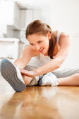 Attractive healthy young woman stretching yoga gym — Stock Photo