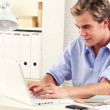 ストックビデオ: Young entrepreneur working from home using laptop in office is happy and smiling with confidence