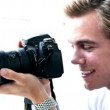 Gorgeous young man with camera — Vídeo de stock