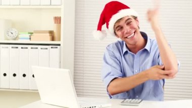 Businessman wearing santa hat for christmas celebrating — Stock Video