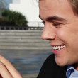 Attractive young businessman chatting on mobile phone outdoors — Stock Video