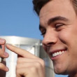 Attractive young businessman sending text message on mobile phone outdoors — Stock Video