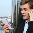 Successful businessman is happy using mobile phone - outdoors — Stock Video