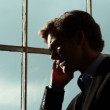 Young businessman on the phone — Stock Video #15446121