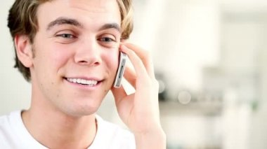 Handsome young man is happy and joyful talking on smartphone — Stock Video