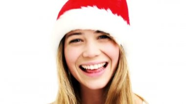 Closeup Portrait of Pretty woman wearing santa hat smiling in high definition — Stock Video