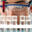 Royalty-Free Stock 矢量图片: Pretty young biology student doing experimental research in science laboratory