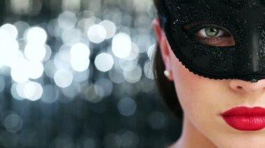Macro closeup of sexy woman wearing masquerade mask at party — Stock Video