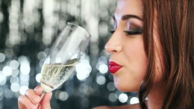 Sexy woman drinking champagne flirting at new years eve party — Stock Video