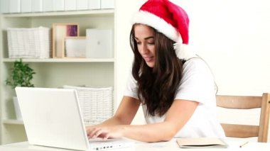Teenager shopping online for christmas presents — Stock Video