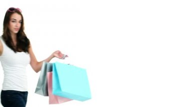 Sexy woman holding shopping bags — Stock Video