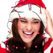Cute girl in the christmas hat decorated with the lights — Stock Video #16022481