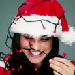 Vídeo Stock: Young girl decorating her hat by the christmas lights