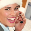 Attractive business woman in santa claus hat — Stock Video