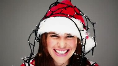 Cute girl in the christmas hat decorated with the lights — Stock Video