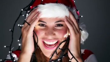 Girl in a christmas hat with decorations — Stock Video