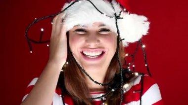 Cute girl tangled in christmas lights — Stock Video