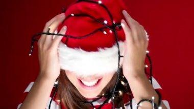 Pretty girl in christmas lights — Stock Video