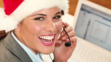 Attractive business woman in santa claus hat — Stock Video #16026293
