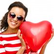 Valentines day portrait of Pretty Mixed race woman holding red heart — Stock Photo