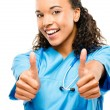 Happy mixed race doctor smiling thumbs up isolated on white background - Stock Photo