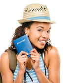 Happy African American woman tourist holding passport — Stock Photo