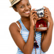 Happy African American woman tourist holding vintage camera isolated on white background — Stock Photo #19471593
