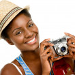 Happy African American woman tourist holding vintage camera isolated on white background — Stock Photo