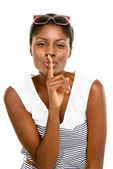 Cute African American woman finger on lips isolated on white bac — Zdjęcie stockowe