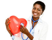 Happy African American trusted Nurse holding Red heart — Zdjęcie stockowe