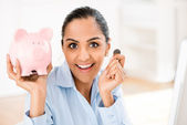 Indian business woman saving money piggy bank — Stock Photo