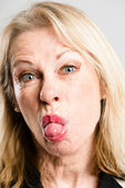 Funny woman portrait real high definition grey background — Stock Photo