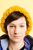 Serious woman portrait real high definition yellow backgr — Stock Photo