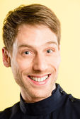 Happy man portrait real high definition yellow background — Stock Photo