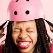 Stock Photo: Funny woman wearing Cycling Helmet portrait pink background