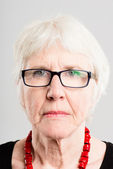 Serious woman portrait real high definition grey backgrou — Stock Photo