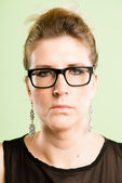Serious woman portrait real high definition green backgro — Stock Photo