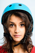 Funny woman wearing cycling helmet portrait real high def — Stock Photo