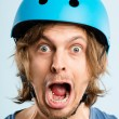 Funny man wearing cycling helmet portrait real - Stock Photo