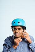 Funny man wearing cycling helmet portrait real high defin — Stock fotografie
