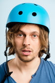 Funny man wearing cycling helmet portrait real high defin — Stok fotoğraf