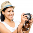 Beautiful mixed race woman taking photograph vintage camera isol — Stock Photo