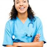 Happy mixed race nurse smiling arms folded isolated on white bac — Stock Photo #27375741