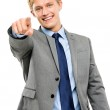 Happy businessman pointing isolated on white background — Stock Photo