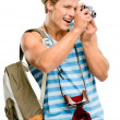 Happy tourist man photographing vintage camera isolated on white — Stock Photo